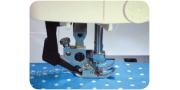 Функция двойной подачи материала на швейной машинке